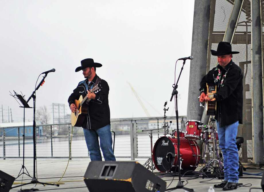 Musicians Keith Kire and Britt Godwin played a set of country music Saturday at Art in the Park in downtown Orange. The annual event, held at the Riverfront Boardwalk and Pavilion, featured arts and crafts booths, live music, food, children's activities and more. Photo: Sarah Moore