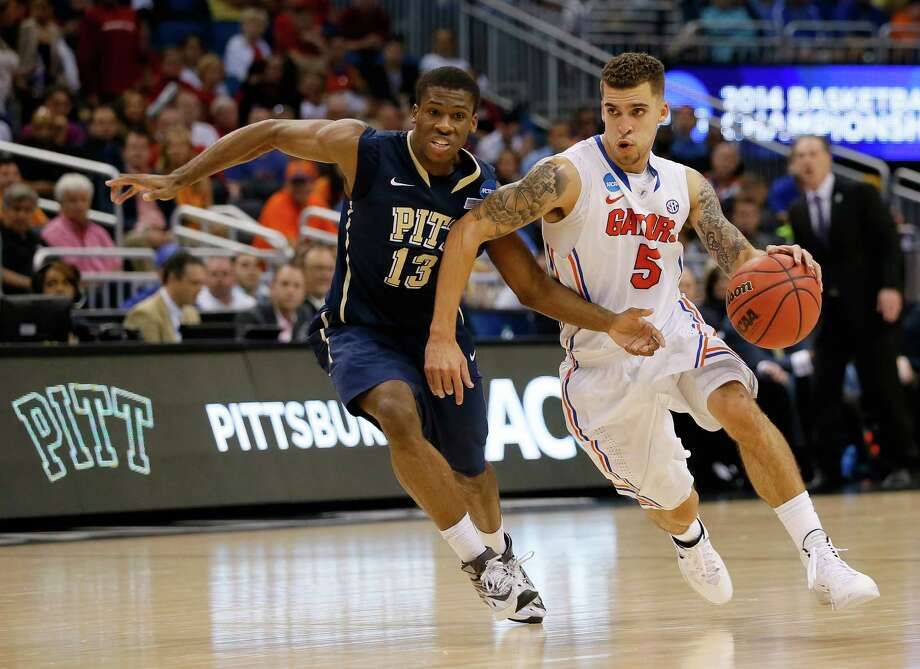 ORLANDO, FL - MARCH 22:  Scottie Wilbekin #5 of the Florida Gators drives on Josh Newkirk #13 of the Pittsburgh Panthers in the second half during the third round of the 2014 NCAA Men's Basketball Tournament at Amway Center on March 22, 2014 in Orlando, Florida.  (Photo by Kevin C. Cox/Getty Images) ORG XMIT: 459540551 Photo: Kevin C. Cox / 2014 Getty Images