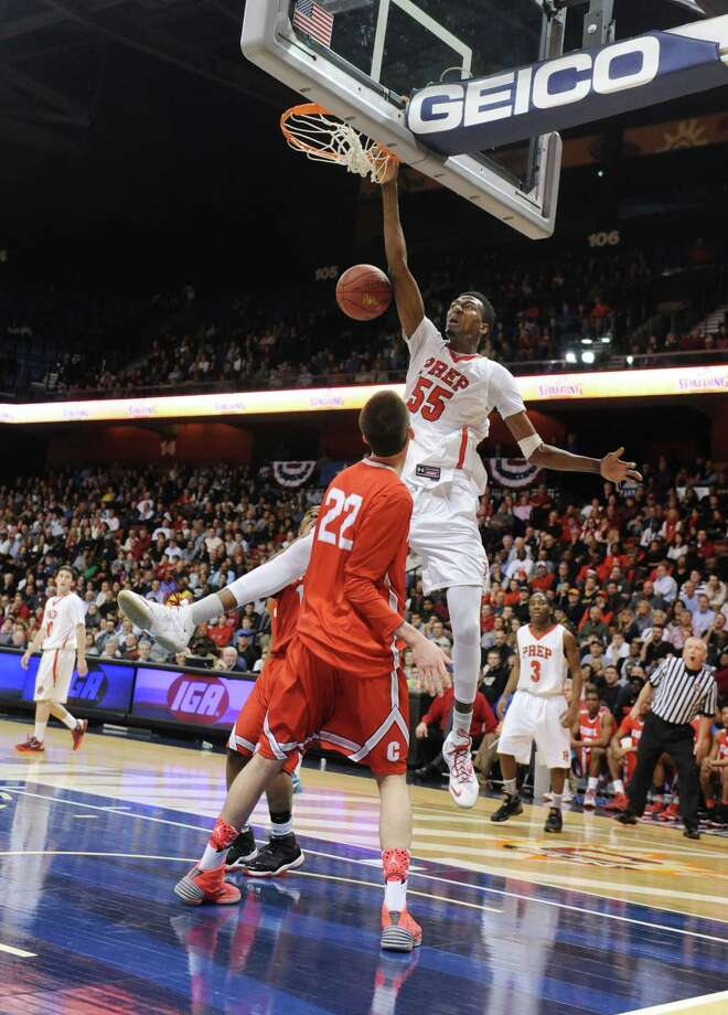 Fairfield Prep's Paschal Chukwu (55) dunks over Bridgeport Central's Orhan Cecunjamin (22) in the CIAC Class LL high school boys basketball state championship game between No. 1 Fairfield Prep. and No. 2 Bridgeport Central at Mohegan Sun Arena in Uncasville, Conn. on Saturday, March 22, 2014. Photo: Tyler Sizemore / The News-Times