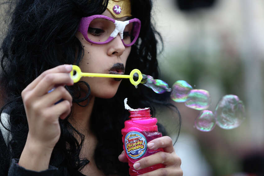Emily Morales, dressed as Fereri from Homestuck blows bubbles, during Mizuumi-Con 7at Our Lady of the Lake University in San Antonio on Saturday, March 22, 1014.