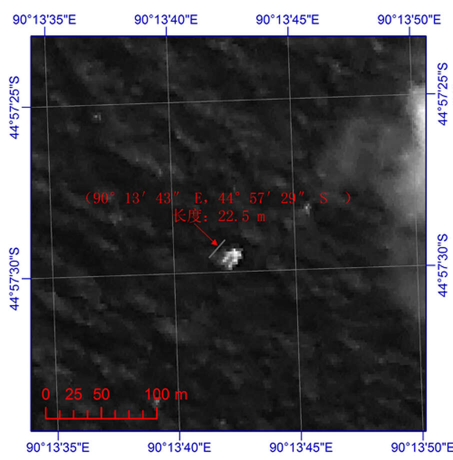 This image provided by China's State Administration of Science, Technology and Industry for National Defense shows a floating object seen at sea next to the descriptor which was added by the source. The image was captured around noon, on March 18, 2014 (Tuesday) by a Chinese satellite in S44'57 E90'13 in south Indian Ocean. It shows what is suspected to be a floating object 22 meters long and 13 meters wide. It is about 120 km south (slightly to the west) of the suspected objects released by Australia. (AP Photo/ China State Administration of Science, Technology and Industry for National Defense) Photo: HOPD /  China State Administration of S