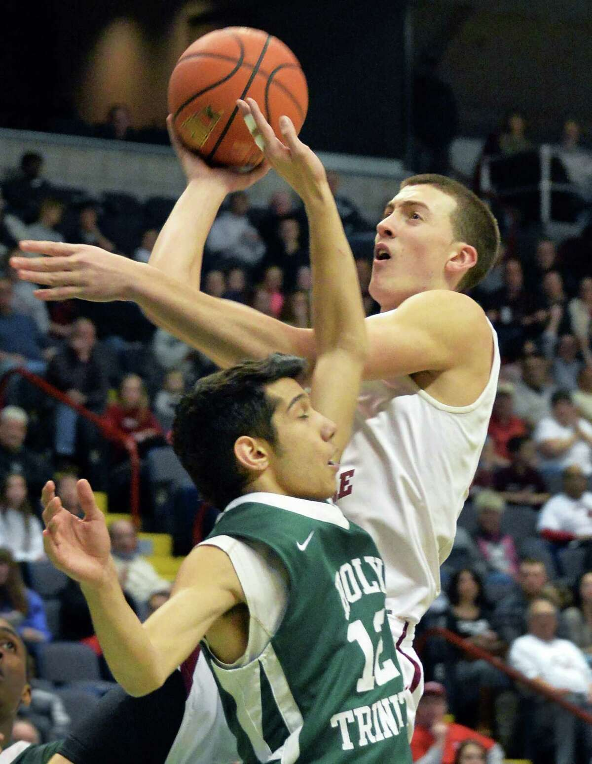Scotia's #24 Joe Cremo, top, battles Holy Trinity's #12 Michael Farella under the basket during the Class A Federation boys' basketball final at the Times Union Center Saturday March 22, 2014, in Albany, NY. (John Carl D'Annibale / Times Union)