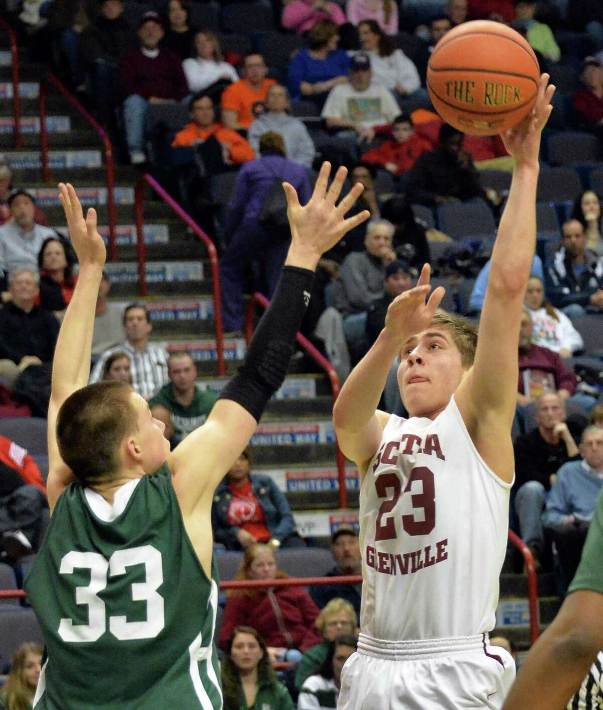 Scotia's #23 Alex Sausville, right, gets a shot past Holy Trinity's #33 James Golaszewski during the Class A Federation boys' basketball final at the Times Union Center Saturday March 22, 2014, in Albany, NY. (John Carl D'Annibale / Times Union)