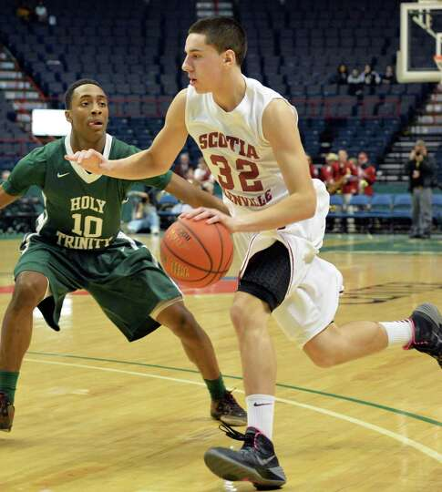Scotia's #32 Dom Lemorta, right, drives past Holy Trinity's #10 Peter Alkins during the Class A Fede
