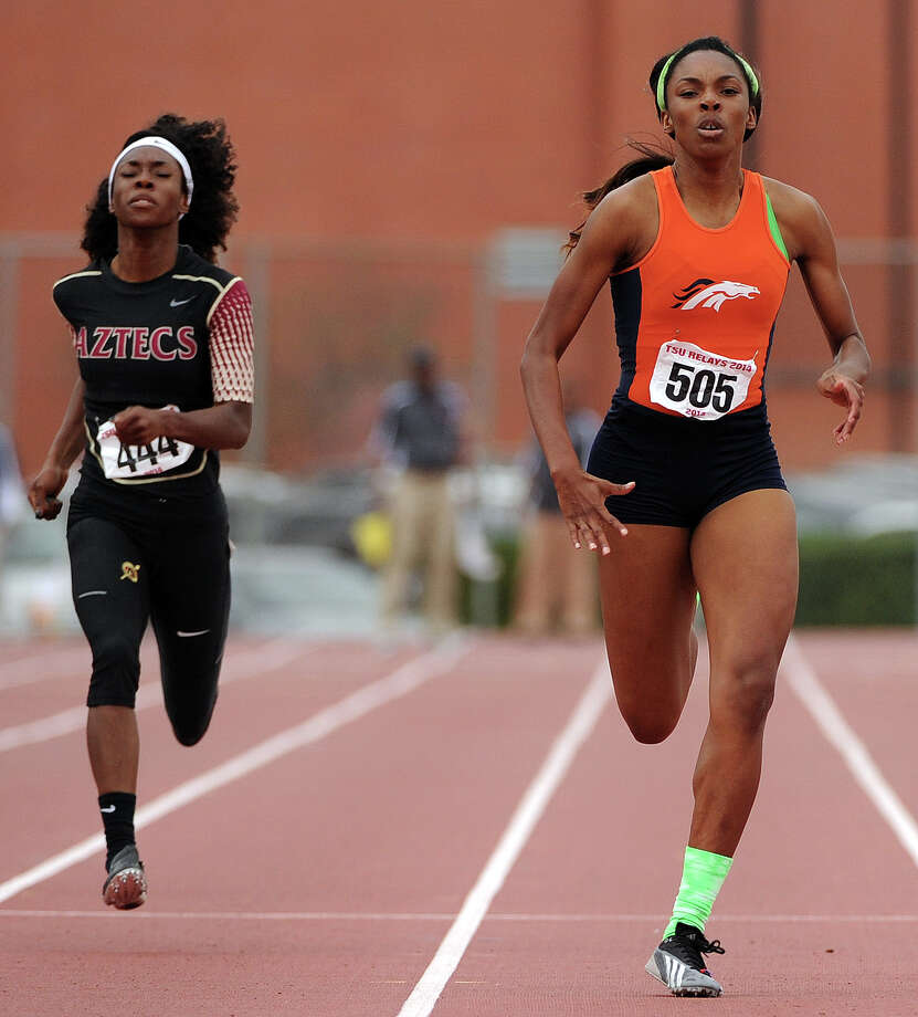Bush's Jara Owens, right, races to the finish line for the victory in the 400-meter dash during the TSU Relays, Saturday, March 22, 2014, at Durley Stadium in Houston. Owens is ranked #5 in the country amongst girls high school track and field athletes. Photo: Eric Christian Smith, For The Chronicle