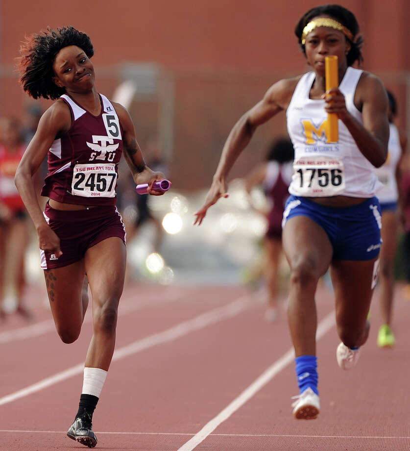 TSU's Breana Dockery, left, runs to the finish line in the women's 4x100 meter relay during the TSU Relays, Saturday, March 22, 2014, at Durley Stadium in Houston. Photo: Eric Christian Smith, For The Chronicle