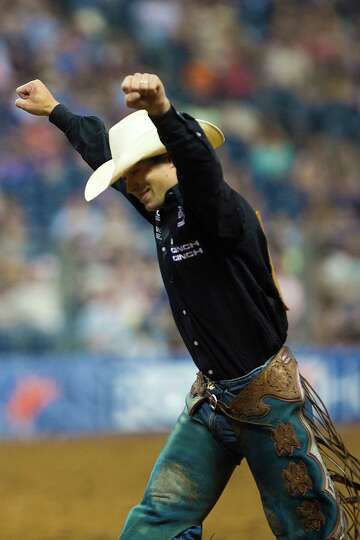 Heith Demoss reacts to a good saddle bronc ride during the BP Super Series Championship, Saturday, M