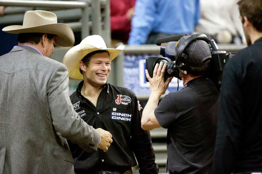 Heith Demoss grins after winning $55,783 as the Saddle Bronc Riding Champion at the RodeoHouston, Saturday, March 22, 2014, in Houston. Photo: Marie D. De Jesus, Houston Chronicle / © 2014 Houston Chronicle