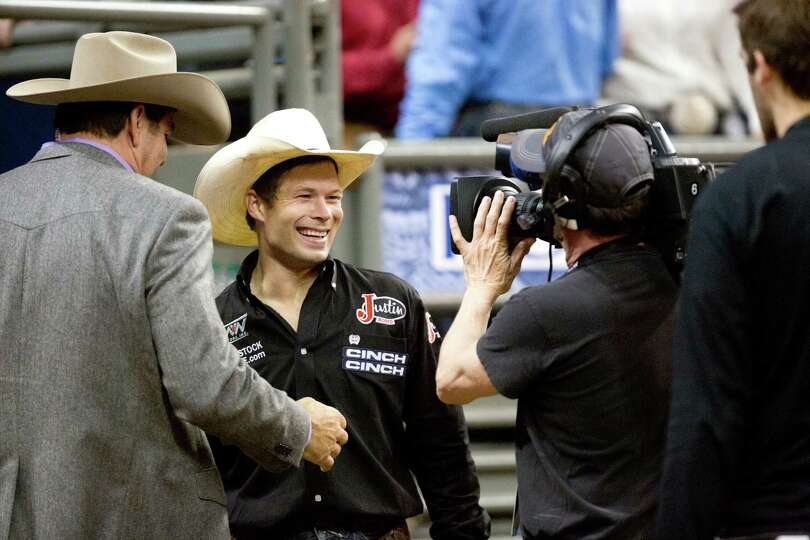 Heith Demoss grins after winning $55,783 as the Saddle Bronc Riding Champion at the RodeoHouston, Sa