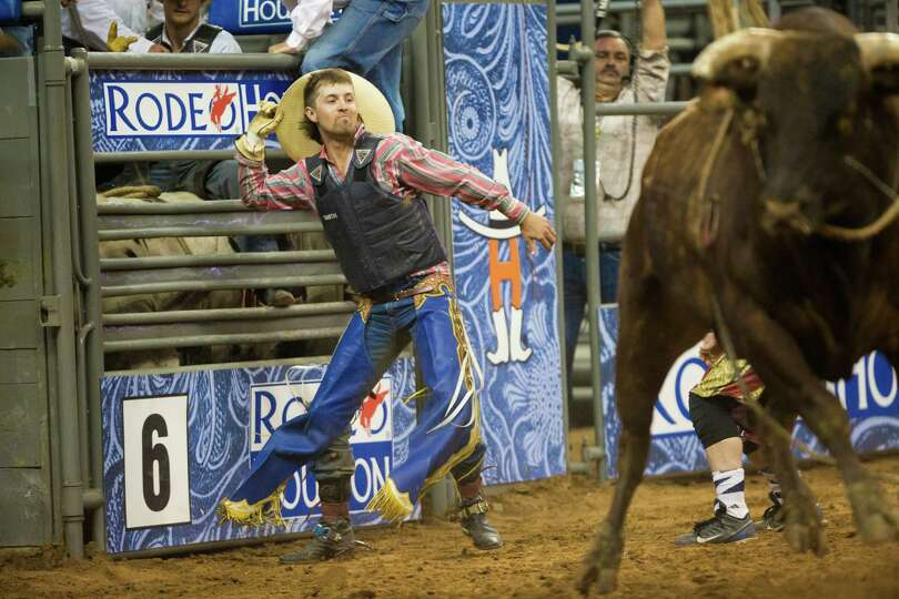 Bull rider Tyler Smith reacts right after scoring 90 points winning the Bull Riding Championship, Sa