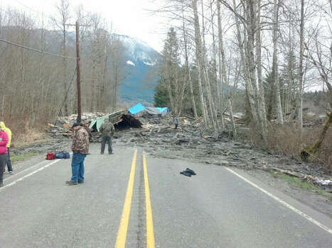 The muddy debris from the landslide overtook a number of homes nearby, killing 14 people. As of March 25, more than 170 people are reported missing. Photo: HOPD / Washington State Patrol