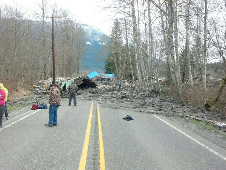 This huge landslide in Snohomish County, Washington, crushed six houses. The slide blocked State Route 530 about 55 miles north of Seattle. Photo: HOPD / Washington State Patrol