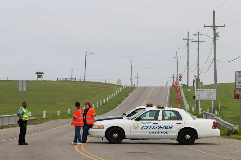 Emergency personnel block the road to the Texas City Dike following a barge collision in the ship channel, causing an oil spill Saturday, March 22, 2014, in Houston. Photo: Brett Coomer, Houston Chronicle / © 2014 Houston Chronicle