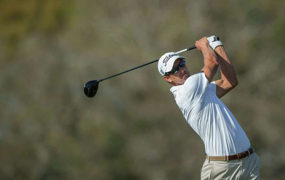 Adam Scott tees off on the 16th hole during the third round of the Arnold Palmer