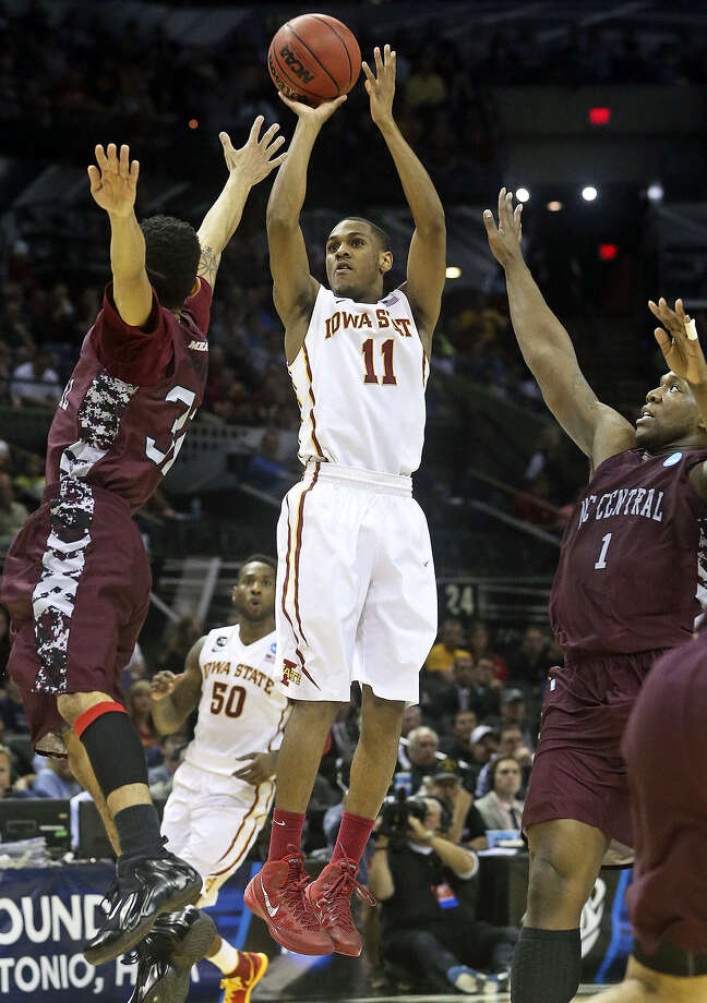 Iowa State guard Monté Morris, shooting against North Carolina Central on Friday night, has what could be a record 5.12 assist-to-turnover ratio. Photo: Tom Reel / San Antonio Express-News