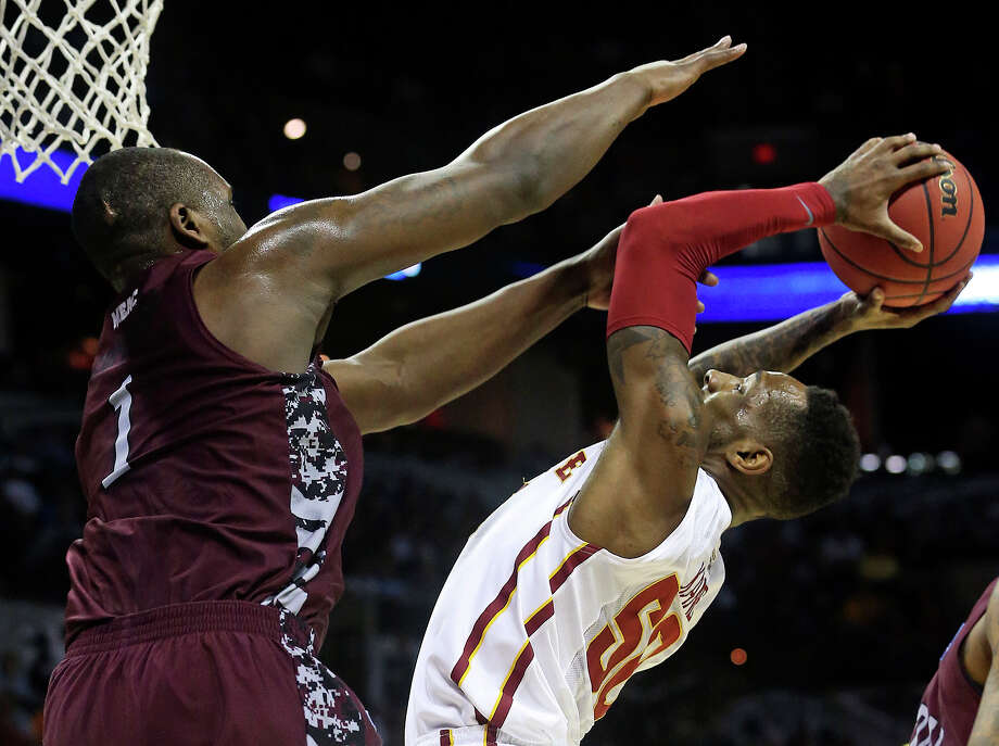 Cyclone guard DeAndre Kane bends under heavy pressure from Jay Copeland as North Carolina Central plays Iowa State in the second round of the 2014 NCAA Division I Men's Basketball Championship at the AT&T Center on March 21, 2014. Photo: For The San Antonio Express-News