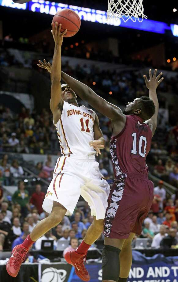 Cyclone guard Monte Morris drives to the hoop but is fouled hard by Karamo Jawara as North Carolina Central plays Iowa State in the second round of the 2014 NCAA Division I Men's Basketball Championship at the AT&T Center on March 21, 2014. Photo: For The San Antonio Express-News