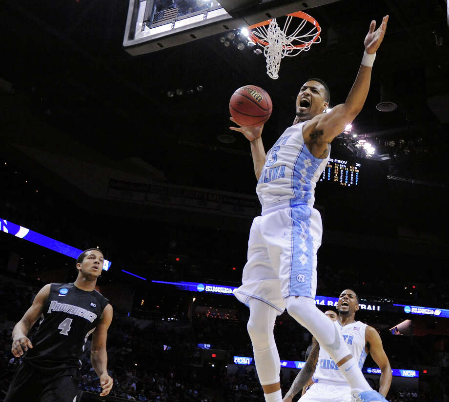North Carolina's J.P. Tokoto (13) reacts after a dunk as Providence's Josh Fortune (04) looks on during first half action of their second round 2014 NCAA Division I Men's Basketball Championship held Friday March 21, 2014 at the AT&T Center. Photo: San Antonio Express-News / © 2014 San Antonio Express-News