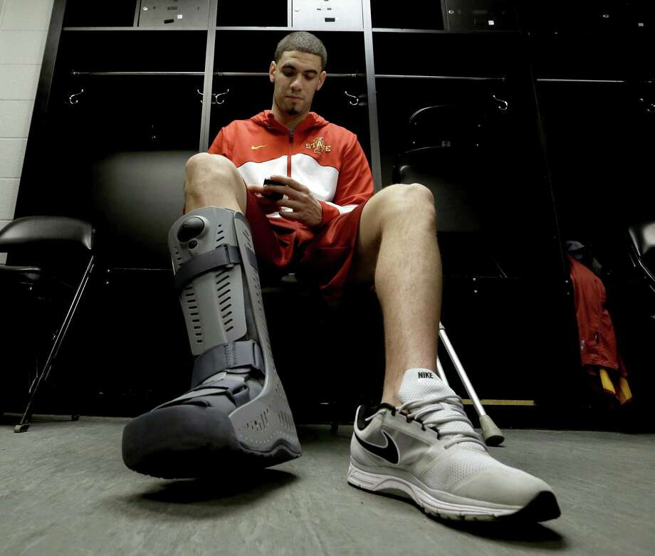 Iowa State's Georges Niang sits in the locker room Saturday with a brace on his broken right foot before the Cyclones' practice at the AT&T Center. Photo: David J. Phillip / Associated Press / AP