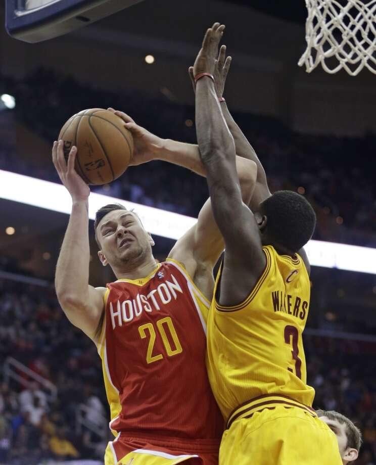 March 22: Rockets 118, Cavaliers 111Rockets forward Donatas Motiejunas attempts a shot over Dion Waiters of the Cavaliers. Photo: Tony Dejak, Associated Press