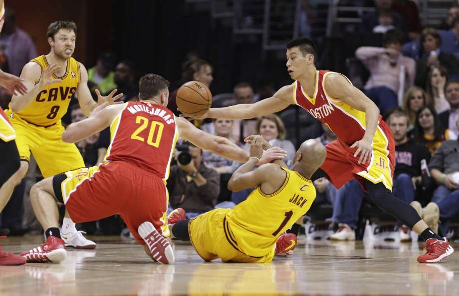 Rockets defenders collapse on Jarrett Jack of the Cavaliers. Photo: Tony Dejak, Associated Press