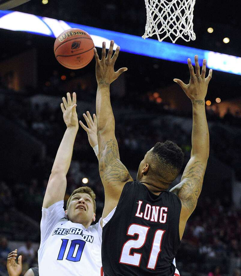 Creighton's Grant Gibbs (10) shoots over Lousiana-Lafayette's Shawn Long (21) during second-round NCAA tournament first-half action in the AT&T Center on Friday, March 21, 2014. Photo: San Antonio Express-News / San Antonio Express-News
