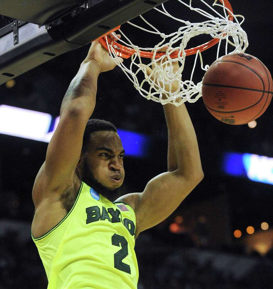 Baylor's Rico Gathers (2) dunks against Nebraska during second-round NCAA tournament second-half action in the AT&T Center on Friday, March 21, 2014. Photo: San Antonio Express-News / San Antonio Express-News