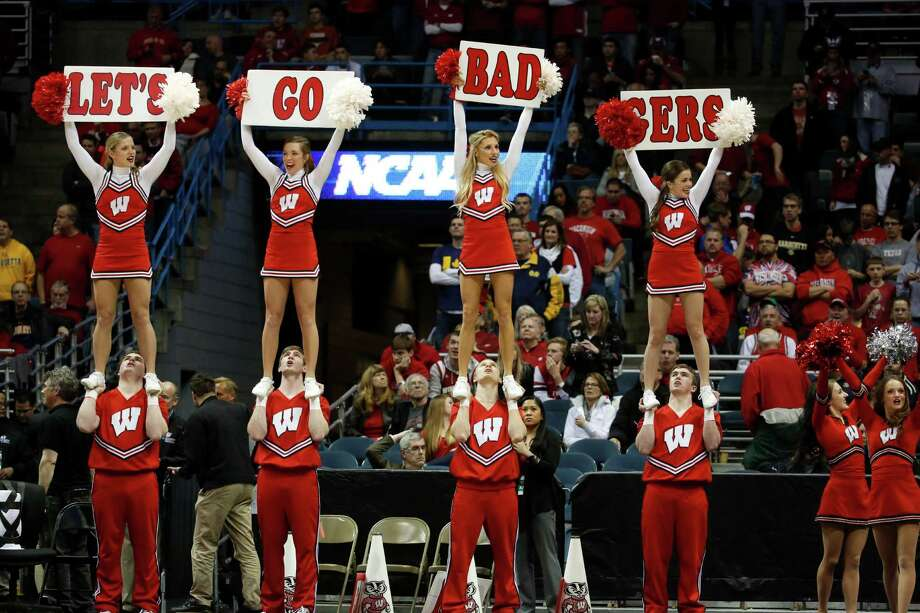 Wisconsin cheerleaders perform during the first half of a third-round game of the NCAA college basketball tournament Saturday, March 22, 2014, in Milwaukee. (AP Photo/Jeffrey Phelps) Photo: Jeffrey Phelps, Associated Press / FR59249 AP