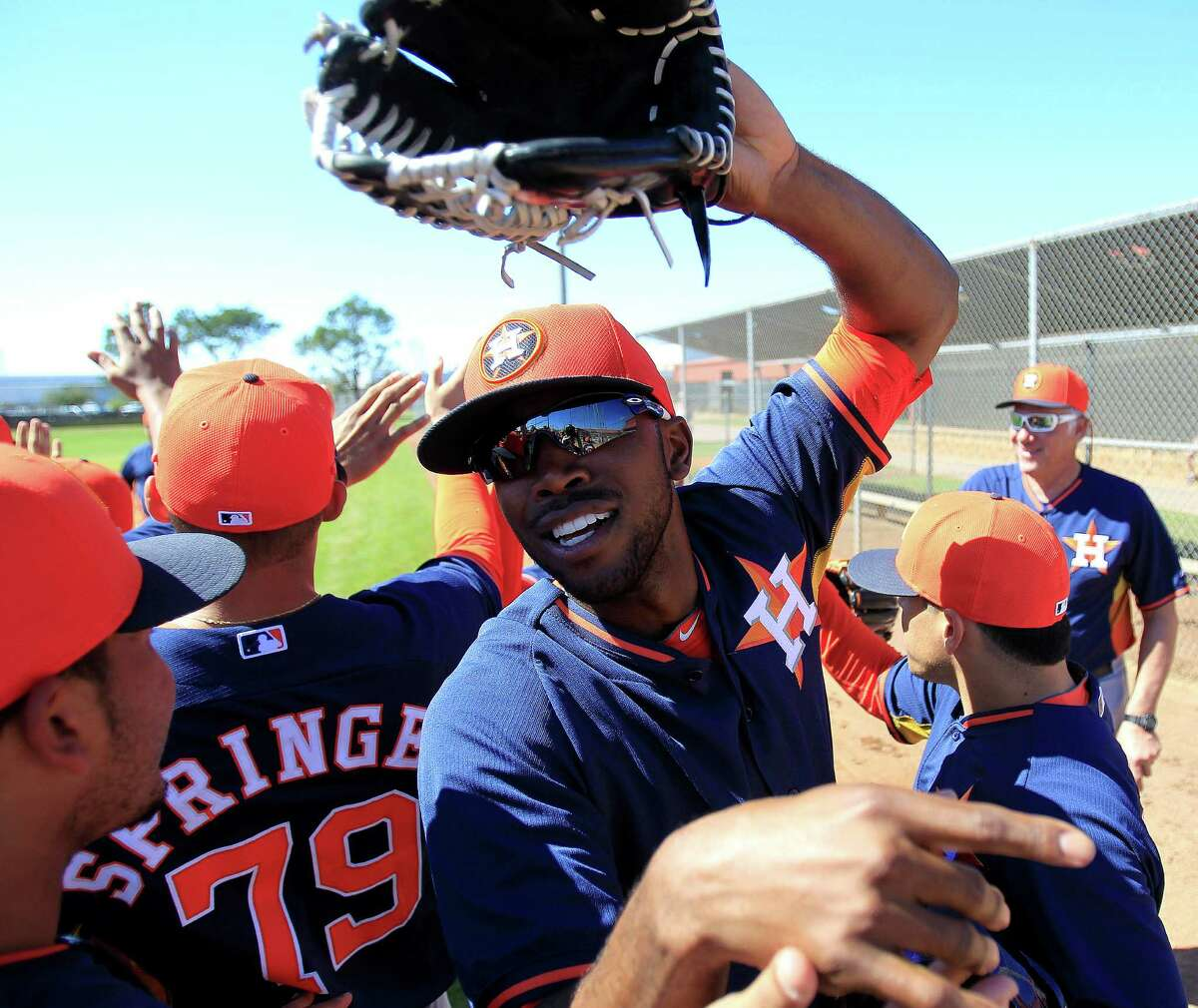 Dexter Fowler, center, has fit right in with his new teammates and looks forward to validating the Astros' trade for him.