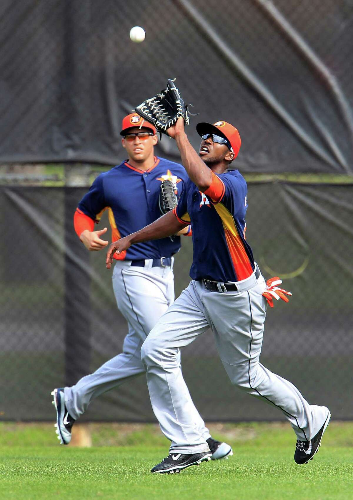Dexter Fowler, right, covers a lot of ground in center field.