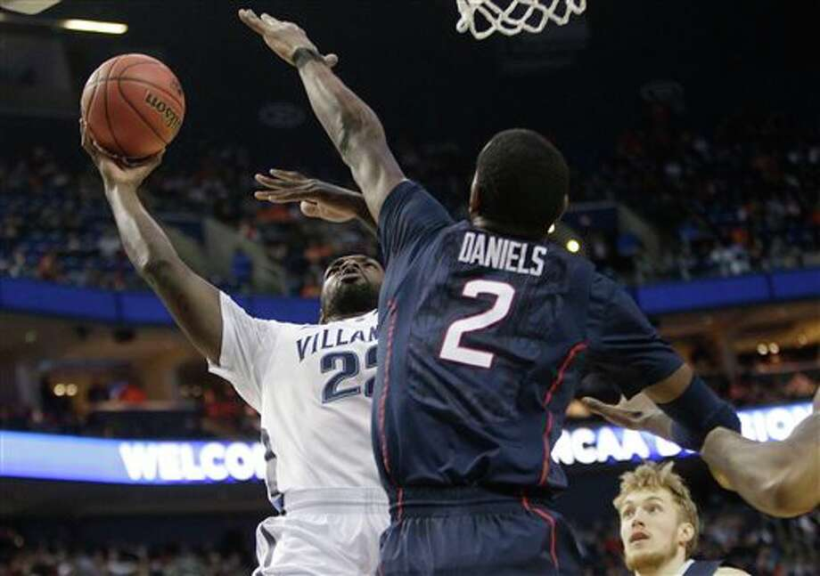 Villanova's JayVaughn Pinkston (22) shoots over Connecticut's DeAndre Daniels (2)  during the first half of a third-round game in the NCAA men's college  basketball tournament in Buffalo, N.Y., Saturday, March 22, 2014. (AP  Photo/Bill Wippert)