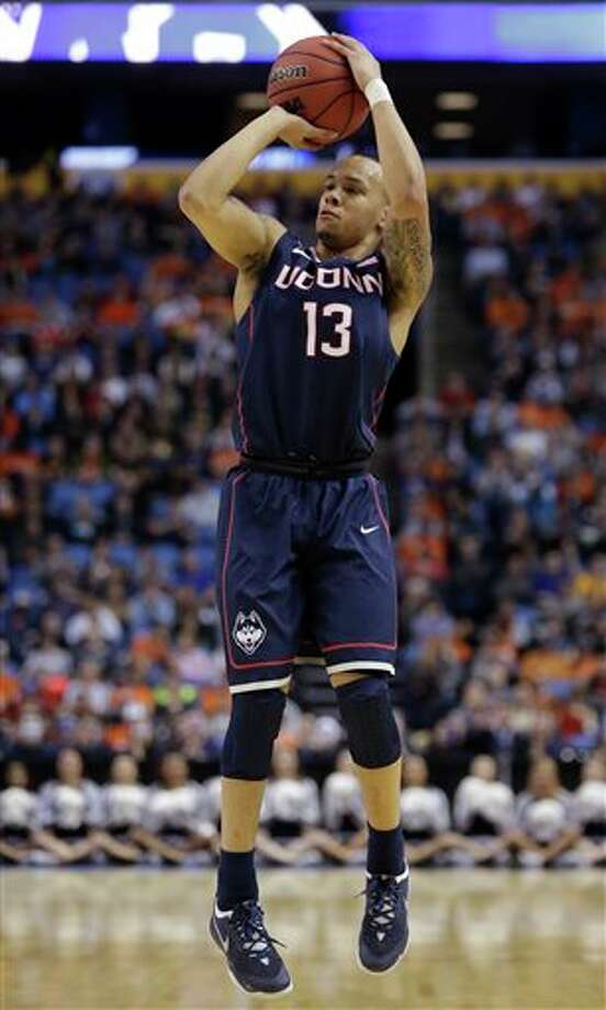 Connecticut's Shabazz Napier shoots during the first half of a third-round game against Villanova in the NCAA men's college basketball tournament in Buffalo, N.Y., Saturday, March 22, 2014. (AP Photo/Nick LoVerde)
