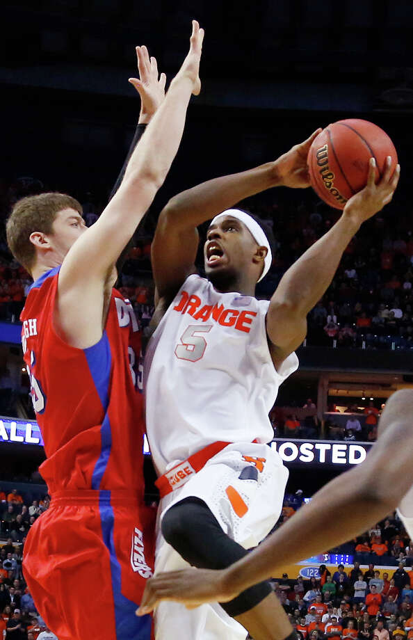 Syracuse's C.J. Fair (5) shoots over Dayton's Matt Kavanaugh (35) during the first half of a third-round game in the NCAA men's college basketball tournament in Buffalo, N.Y., Saturday, March 22, 2014. (AP Photo/Bill Wippert) ORG XMIT: NYFF126 Photo: Bill Wippert / FR170745 AP