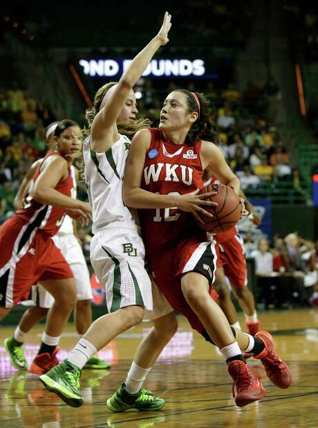 Baylor's Makenzie Robertson, left, tries to stop a drive by Kendall Noble. Photo: Tony Gutierrez, STF / AP