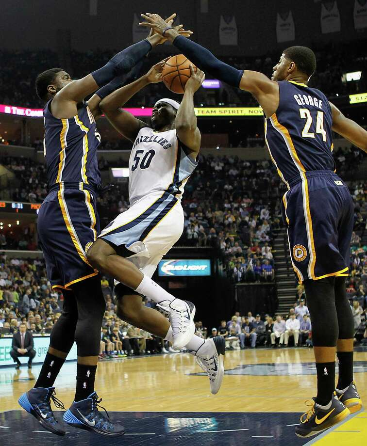 Memphis Grizzlies forward Zach Randolph (50) goes to the basket against Indiana Pacers center Roy Hibbert (55) and forward Paul George (24) in the first half of an NBA basketball game on Saturday, March 22, 2014, in Memphis, Tenn. (AP Photo/Lance Murphey) ORG XMIT: TNLM102 Photo: Lance Murphey / FR78211 AP