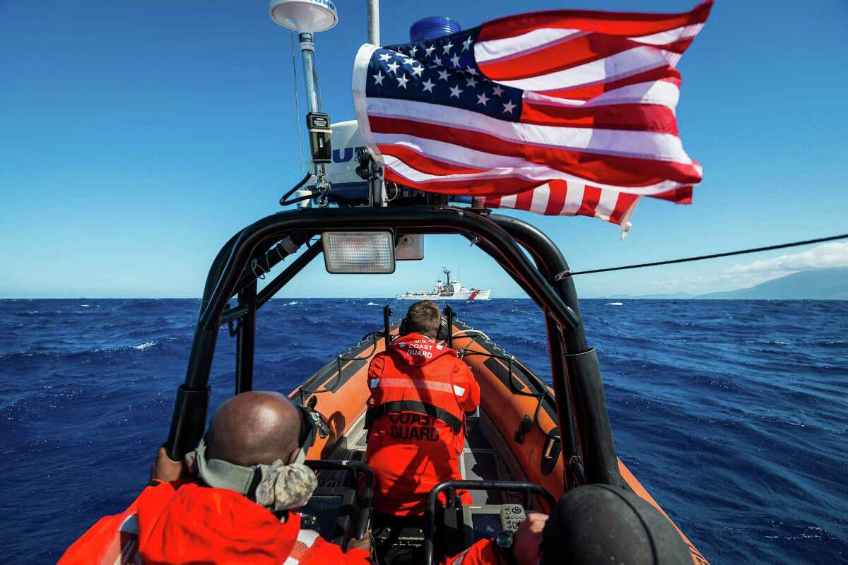 Petty Officer 1st Class Nicholas Freeman pilots a speedboat to the Coast Guard Cutter Dauntless during a recent patrol near Haiti. The 210-foot ship, which is based out of Galveston, has distinguished itself for the amount of drugs it has captured. ( Smiley N. Pool / Houston Chronicle )