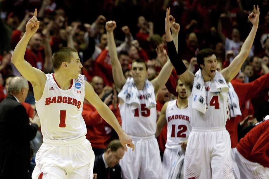 MILWAUKEE, WI - MARCH 22:  Ben Brust #1 of the Wisconsin Badgers celebrates a three point shot in the second half against the Oregon Ducks during the third round of the 2014 NCAA Men's Basketball Tournament at BMO Harris Bradley Center on March 22, 2014 in Milwaukee, Wisconsin.  (Photo by Mike McGinnis/Getty Images) ORG XMIT: 459540487 Photo: Mike McGinnis / 2014 Getty Images