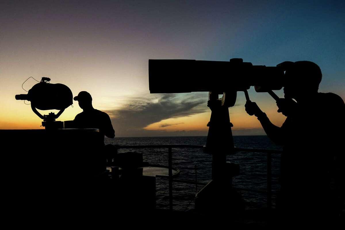 Crew work as lookouts aboard the Coast Guard Cutter Dauntless during a recent patrol in the Caribbean Sea. ( Smiley N. Pool / Houston Chronicle )