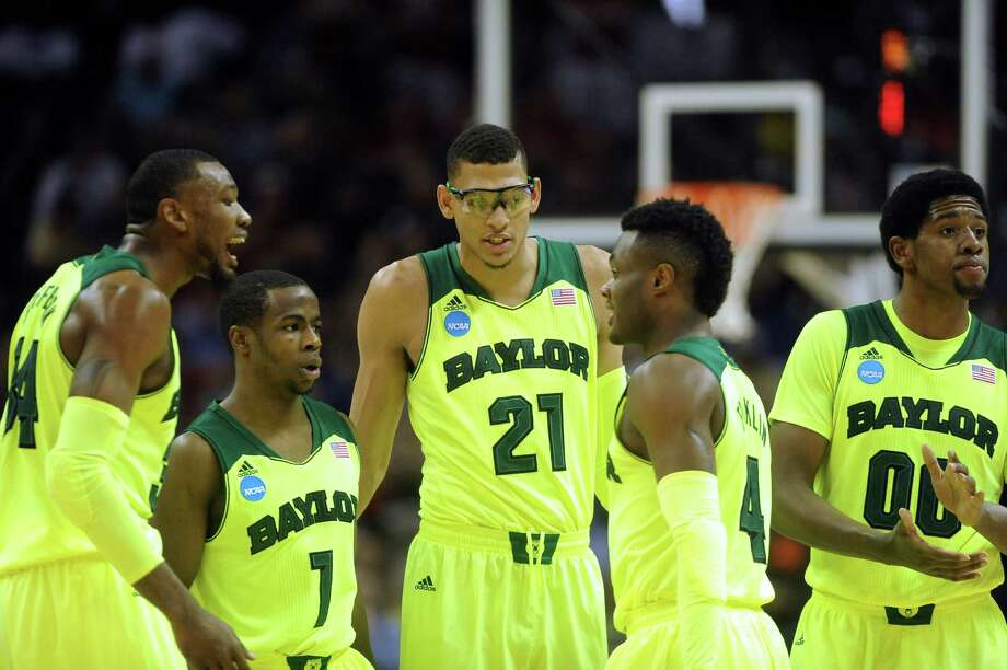 Baylor's Cory Jefferson (34), left, Kenny Chery (01), Isaiah Austin (21), Gary Franklin (04) and Royce O'Neale (00) gather on the court during second-round NCAA tournament action against Nebraska in the AT&T Center on Friday, March 21, 2014. Photo: San Antonio Express-News / San Antonio Express-News