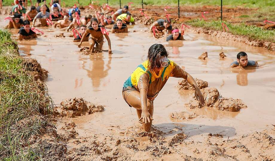 SMITHVILLE, TX - MARCH 22:  Runners participate in Warrior Dash, World's Largest Obstacle Race Series on March 22, 2014 in Smithville, Texas.  (Photo by Rick Kern/Getty Images for Warrior Dash) Photo: Rick Kern, Getty Images For Warrior Dash