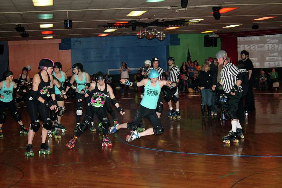 "Were You Seen at the Hellions of Troy Roller Derby's first bout of the season at Rollarama in Schenectady on Saturday, March 22, 2014? Photo: Alana O'Hair ""Vulcanizer"""