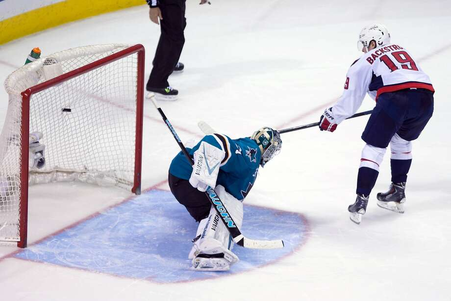 Nicklas Backstrom scores a shootout goal past Antti Niemi to give Washington the victory and prevent the Sharks from clinching a spot in the playoffs. Photo: Kelley L Cox, Reuters