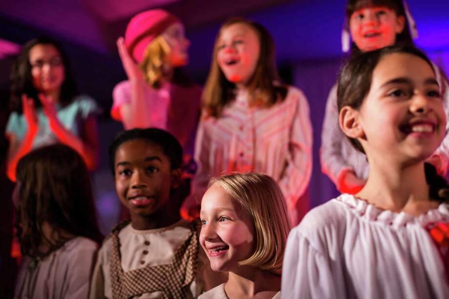 Participants smile and wave at family members from the stage following their performances at the eighth annual American Girl Fashion Show Saturday, March 22, 2014, at the The Golf Club at Newcastle in Newcastle, Wash. This year, the event raised an estimated 100,000 dollars for Seattle Children's Hospital. Photo: JORDAN STEAD, SEATTLEPI.COM / SEATTLEPI.COM