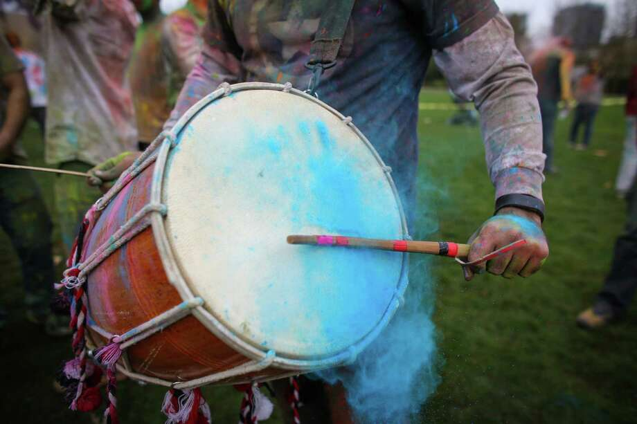 Colored powder falls off a drum as it is beaten during the annual Holi celebration organized by the group Child Rights and You. The annual event celebrates the Indian festival of color and is a fundraiser for CRY. Holi recognizes the coming of spring with colored powder that people throw on each other. Photographed on Saturday, March 22, 2014 at Downtown Park in Bellevue. Photo: JOSHUA TRUJILLO, SEATTLEPI.COM / SEATTLEPI.COM