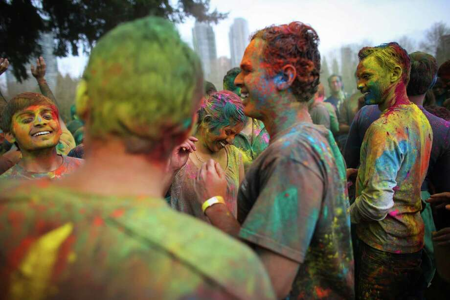 Participants dance during the annual Holi celebration organized by the group Child Rights and You. The annual event celebrates the Indian festival of color and is a fundraiser for CRY. Holi recognizes the coming of spring with colored powder that people throw on each other. Photographed on Saturday, March 22, 2014 at Downtown Park in Bellevue. Photo: JOSHUA TRUJILLO, SEATTLEPI.COM / SEATTLEPI.COM