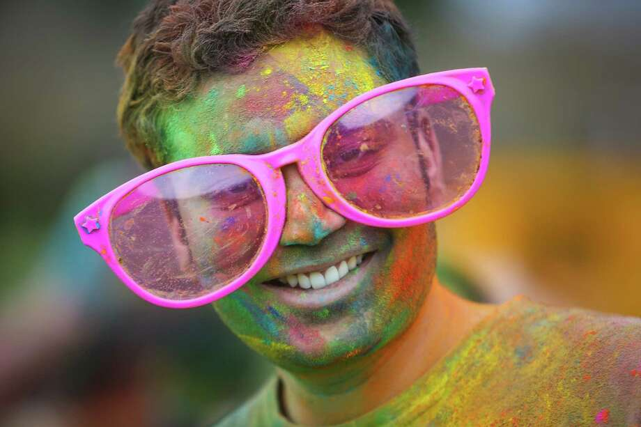 A participant has fun during the annual Holi celebration organized by the group Child Rights and You. The annual event celebrates the Indian festival of color and is a fundraiser for CRY. Holi recognizes the coming of spring with colored powder that people throw on each other. Photographed on Saturday, March 22, 2014 at Downtown Park in Bellevue. Photo: JOSHUA TRUJILLO, SEATTLEPI.COM / SEATTLEPI.COM