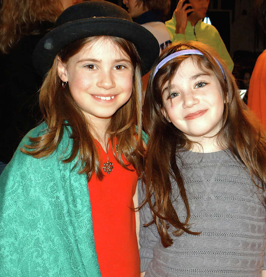 Westporters Beatrice Hobbs, 8, and Sasha Weisman, 9, at the Autism Rocks benefit concert Saturday. Photo: Mike Lauterborn / Westport News