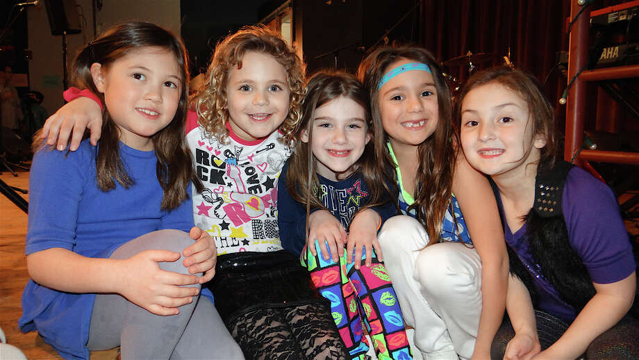 Emma Schorr, 7; Eliza Walmark, 7; Shelby Weisman, 7; Cici Petrosinelli, 6, and Charlotte Frank, 6, turned out for the Autism Rocks concert. Photo: Mike Lauterborn / Westport News
