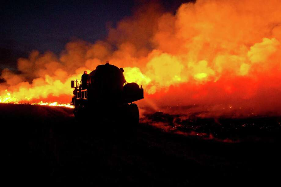 A water tanker from Wabaunsee County helps provide mutual aid Thursday evening March 21, 2014 after a pasture fire spread from Northern Lyon County. Photo: Matthew Fowler, AP / Emporia Gazette