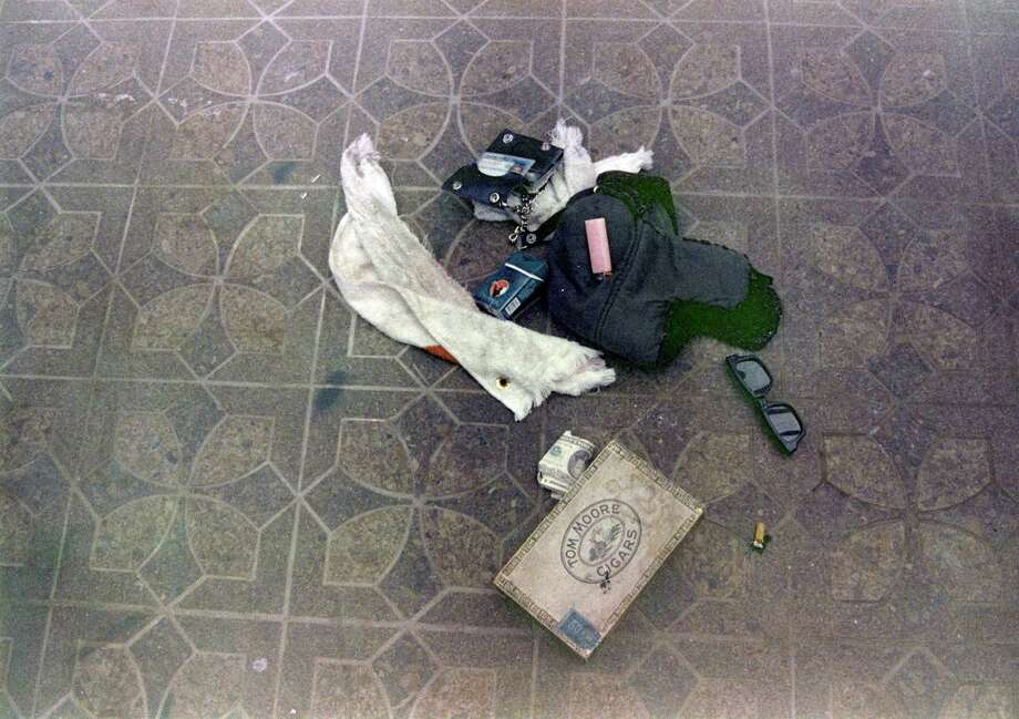 This April 1994 photo provided by the Seattle Police Department shows items found at the scene of Kurt Cobain's suicide, in Seattle. The image has never before been released. Police spokeswoman Renee Witt said Thursday, March 20, 2014, that several rolls of undeveloped film were found when a detective re-examined the Cobain case recently. Photo: Uncredited, AP / AP2014